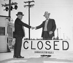 Japanese-American Shuichi Yamamoto shaking hands with camp director James Lindley as Granada Relocation Center in Amache, Colorado, United States closed down, 15 Oct 1945