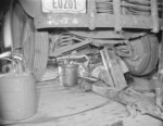 Japanese-American mechanic working under a vehicle, Jerome War Relocation Center, Arkansas, United States, 17 Nov 1942