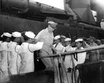 Douglas MacArthur disembarking destroyer USS Buchanan at Yokohama, Japan after being transferred ashore from the USS Missouri where the Japanese surrender was signed, 2 Sep 1945