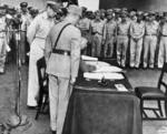 Xu Yongchang signing the surrender document on behalf of China aboard USS Missouri, Tokyo Bay, Japan, 2 Sep 1945, photo 2 of 5