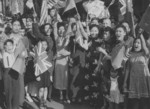 Chinese-Canadians celebrating victory over Japan, 16 Aug 1945; note flags of Canada, United States, Soviet Union, United Kingdom, and China being displayed