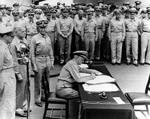 Nimitz signing the instrument of surrender, Tokyo Bay, Japan, 2 Sep 1945, photo 1 of 2