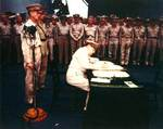 MacArthur signing Japanese surrender aboard USS Missouri, 2 Sep 1945, photo 2 of 4