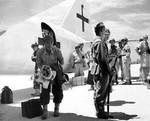 Aboard two Mitsubishi G4M 'Betty' bombers in surrender markings, a Japanese delegation stopped at Ie Jima, Ryukyu Islands en route Manila, Philippines for a surrender briefing, 19 Aug 1945. Photo 07 of 12.