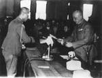 Chen Yi accepting surrender from Rikichi Ando, Taipei City Hall, Taiwan, 25 Oct 1945