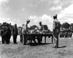 Lieutenant General Stilwell accepted Japanese surrender at US Tenth Army Headquarters, Okinawa, 7 Sep 1945. Note Japanese commander Lt General Toshiro Nomi at left in pith helmet.