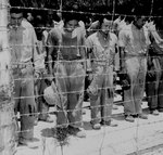 Japanese POWs at Guam bowed their heads after hearing Emperor Showa