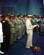 General Douglas MacArthur speaking aboard USS Missouri, Tokyo Bay, Japan, 2 Sep 1945, 1 of 4
