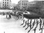 Japanese-American soldiers marching in the V-J Day parade, Livorno, Italy, Sep 1945