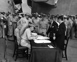 Lieutenant General Sutherland correcting Japanese surrender document, 2 Sep 1945, photo 1 of 2