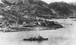 Cruiser HMS Swiftsure entering Victoria Harbour, Hong Kong through North Point, 30 Aug 1945