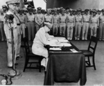 MacArthur signing Japanese surrender aboard USS Missouri, 2 Sep 1945, photo 3 of 4