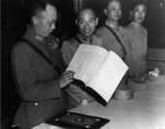 General First Class He Yingqin, General Second Class Gu Zhutong, and Lieutenant General Xiao Yisu inspecting the Japanese instrument of surrender, Nanjing, China, 9 Sep 1945