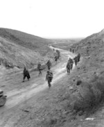 American troops marching through the Kasserine Pass, Tunisia, 26 Feb 1943