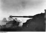German Panzer VI/Tiger I tanks passing burning buildings during the Battle of Kursk in Orel (Oryol), Russia, mid-Jul 1943