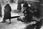 Nurses tending to a wounded man after a German bombardment on Leningrad, Russia, 10 Sep 1941