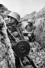 Soviet troops in a trench in Leningrad, Russia, 1 Sep 1941; note DP machine gun