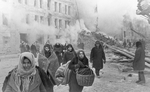 Russian civilians on a street in Leningrad, Russia, 10 Dec 1942; note damaged building in background