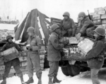 African-American US Army soldiers of 4185th Quartermaster Service Company unloading rations from a truck, Liege, Belgium, 1944