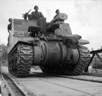 Sexton 25-pounder self-propelled howitzer of UK 11th Armored Division cross the Seine River, France on a Bailey bridge, 30 Aug 1944