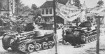 Japanese Type 95 and Type 97 tanks in a town in Malaya, circa Dec 1941-Feb 1942