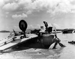 Wreck of D3A Type 99 carrier dive bomber at Agat beachhead, Guam, Mariana Islands, possibly shot down by naval gunfire during or after the landings; photo taken on 28 Jul 1944
