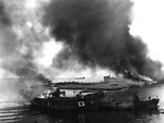 Japanese vessels burning at a harbor near Garapan, Saipan, Mariana Islands, Jun 1944