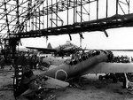 Wrecked C6N-1 aircraft of Japanese Navy 121st Kokutai in a hangar, Ushi Point Airfield, Tinian, Mariana Islands, 30 Jul 1944. Note the Marine Corps Curtiss R5C-1 Commando in the background.