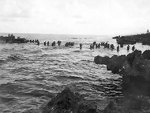 American reinforcements wading onto Tinian, Mariana Islands, Jul 1944