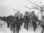 US Marines marching through Garapan, Saipan, Mariana Islands, 6 Jul 1944