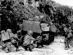 US Marines advancing under the cover of a M4 Sherman medium tank, northern Saipan, Mariana Islands, 8 Jul 1944
