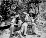 African-American US Marines Sergeant F. Smit and Corporal S. Brown opening a coconut, Saipan, Mariana Islands, Jun 1944