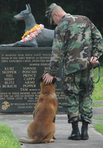 Petty Officer 2nd Class Blake Soller and Military Working Dog Rico at the War Dog Cemetery at Naval Base Guam, Santa Rita, US Territory of Guam, 24 May 2009