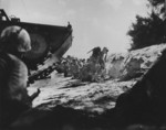 Men of the first wave of US Marines to land on Saipan, Mariana Islands, 15 Jun 1944
