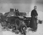 US Navy Chaplain O. David Herrmann preparing to hold religious service for US Marines on Saipan, Mariana Islands, 24 Jun 1944; note wrecked Type 95 Ha-Go light tank used as altar