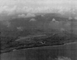 TBF aircraft from USS Coral Sea flying over Aslito Airfield, Saipan, Mariana Islands, 20 Jun 1944