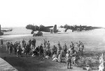 British men of 3rd Platoon, 21st Independent Parachute Company at Fairford, Gloucestershire, England, United Kingdom for Operation Market I, 17 Sep 1944; note background Stirling Mark IV aircraft of 6