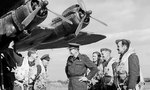 Wing Commander G. E. Harrison of 190 Squadron RAF recounting Operation Market I glider towing mission to Group Captain A. H. Wheeler, Fairford, Gloucestershire, England, United Kingdom, 17 Sep 1944
