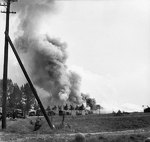 A convoy of British trucks under German artillery and mortar fire on the road between Son and Eindhoven, the Netherlands, 20 Sep 1944
