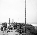 17-pdr anti-tank gun of the 21st Anti-Tank Regiment, British Guards Armoured Division, guarding the approaches to Nijmegen Bridge, the Netherlands, 21 Sep 1944