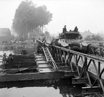 M10 Wolverine tank destroyers of 75th Anti-Tank Regiment Royal Artillery of British 11th Armoured Division crossing a Bailey bridge over the Meuse-Escaut (Maas-Schelde) Canal at Lille St Hubert, Belgium, 20 Sep 1944