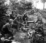 Vickers machine guns of 2nd Middlesex Regiment, British 3rd Division firing in support of troops crossing the Meuse-Escaut (Maas-Schelde) Canal at Lille-St. Hubert, Belgium, 20 Sep 1944