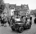 Dutch civilians riding on a British jeep during the advance towards Nijmegen, the Netherlands, 20 Sep 1944