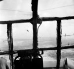 A photograph taken through the window of a troop carrying glider during Operation Market Garden, 17 Sep 1944; note other Allied aircraft and the Dutch coast in distance