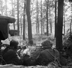 Two British airborne troops dug in at their brigade headquarters near Arnhem, Gelderland, the Netherlands, 18 Sep 1944