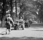 Men of the UK 2nd Battalion, South Staffordshire Regiment marching with their vehicles and equipment along a road between Oosterbeek and Arnhem, the Netherlands, 19 Sep 1944