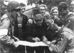 Troops of US 101st Airborne Division receiving information from Dutch resistance members, Eindhoven, the Netherlands, Sep 1944