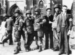 Troops of US 101st Airborne Division with members of Dutch resistance at the Sint-Lambertuskerk cathedral, Veghel, Netherlands, Sep 1944