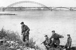 British Royal Engineers 1st Para Squadron Cpl John Humphreys, Cpl Charles Weir, Lt Dennis Simpson, Cpt Eric Mackay at Nijmegen, Holland, recreating their escape from German captivity, 23 Sep 1944