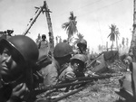 Men of the US Marine Corps 22nd Regiment taking position on Eniwetok, Marshall Islands, 17-21 Feb 1944